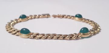 A yellow gold marked 750 link bracelet with four cabochan emeralds, approx. weight 24gms. IMPORTANT: