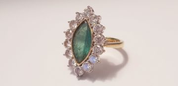 A yellow gold marked 750, Marquise emerald and diamond cluster ring, 14 diamonds surrounding