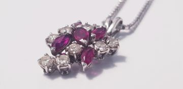 """A ruby and diamond cluster pendant marked 750, on a chain marked 9k, approx. length of chain 15"""","""
