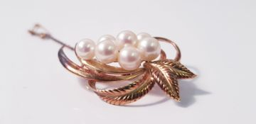 A Mikimoto pearl brooch, set with seven variously sized pearls, smallest measuring approx. 6mm and