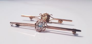 A 9ct yellow gold seed pearl and aquamarine bar brooch, approx. weight 3gms and another bar brooch