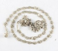 A white metal chain, of open metalwork design with a tassel to either end, (A/F). IMPORTANT: