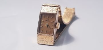 An Omega Lady's gold bracelet wrist watch, marked 375, approx. weight 27gms. IMPORTANT: Online