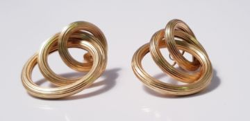 A pair of yellow metal triple hoop earrings, approx. weight 8gms. IMPORTANT: Online viewing and