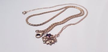 """A yellow metal link chain, approx. length 15"""",approx. weight 7.3gms and a gem stone floral design"""