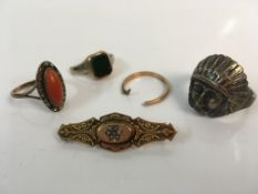 A 9ct yellow gold Victorian brooch with a silver Indian Chief design ring, unmarked gemstone ring