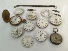 Two pocket watches together with a selection of watch faces, a chain and other parts. Online viewing