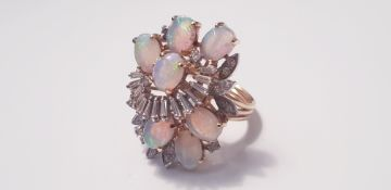 A yellow gold marked 14k opal and diamond dress ring, ring size P, approx. weight 9gms. On line