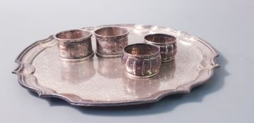 A plated ware tray, approx, width 10 with four various napkin rings, two hallmarked. Online