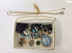 A collection of costume jewellery to include bead necklaces, two strings of pearl design A/F,