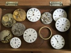 A box containing watch faces and other parts including Russell & Son, J.G. Graves, etc. Online