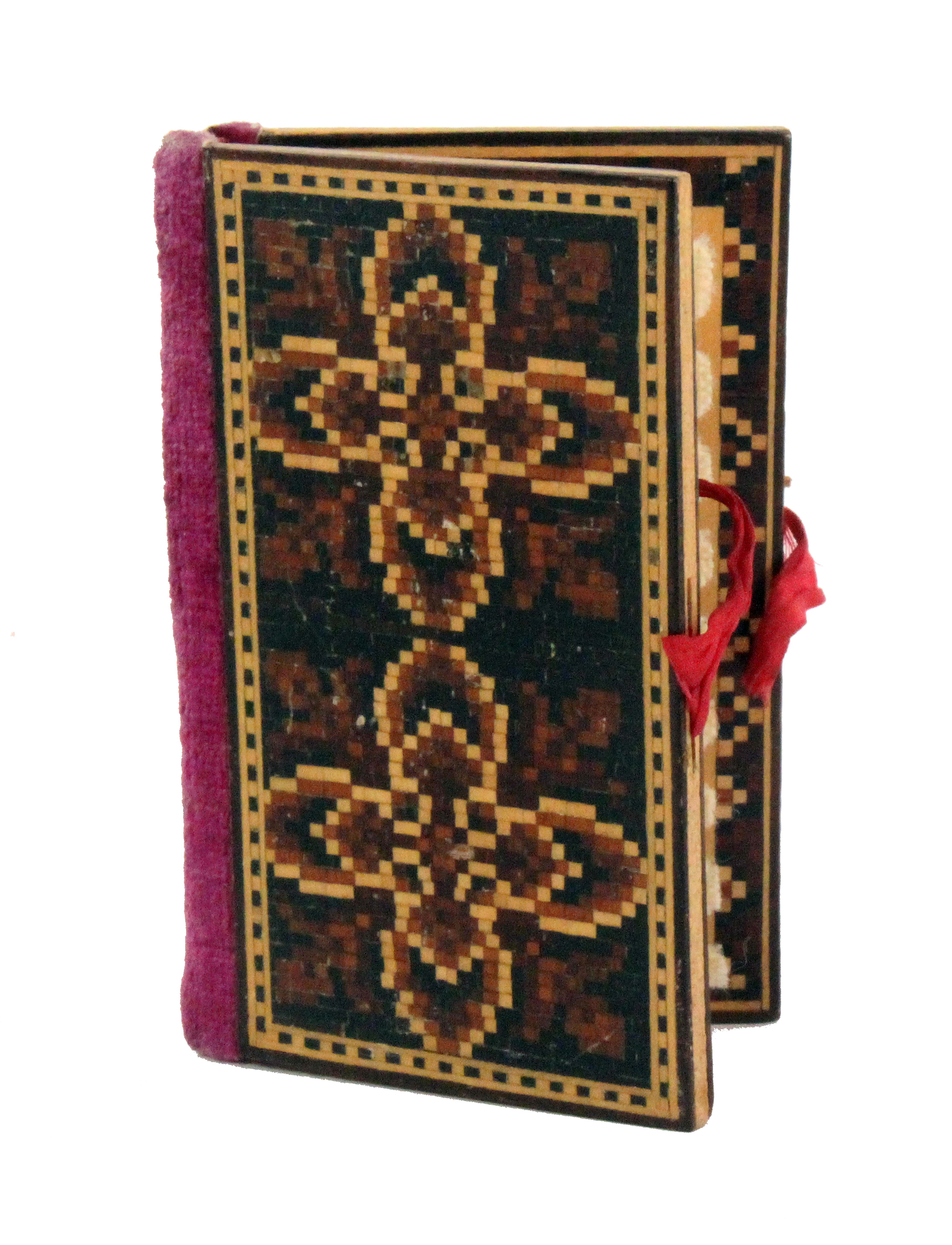 An attractive Tunbridge ware needle book, the covers in geometric mosaic, velvet spine, mosaic