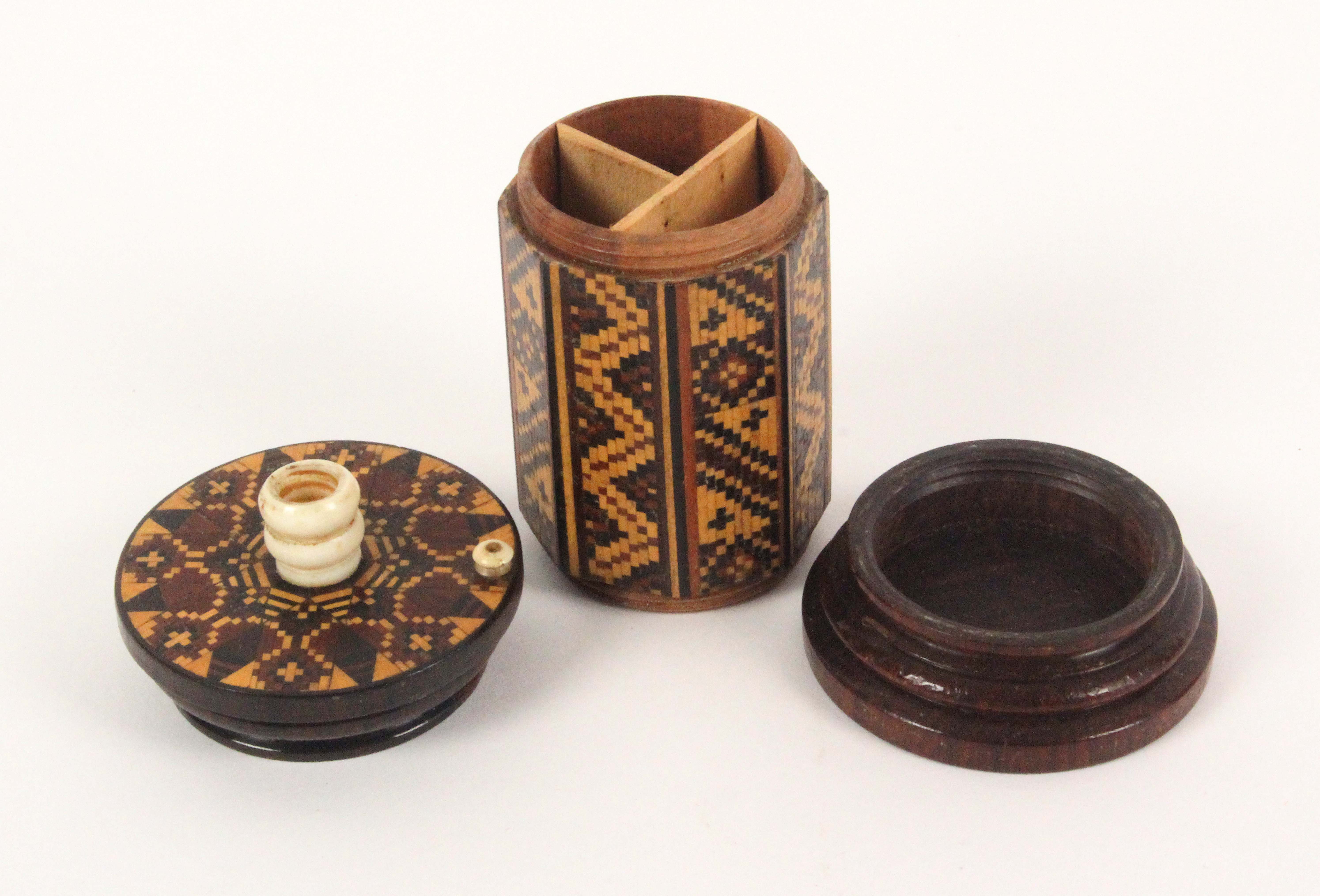 Lot 22 - A rosewood Tunbridge ware 'go to bed', the turned base to a geometric mosaic octagonal body, the top