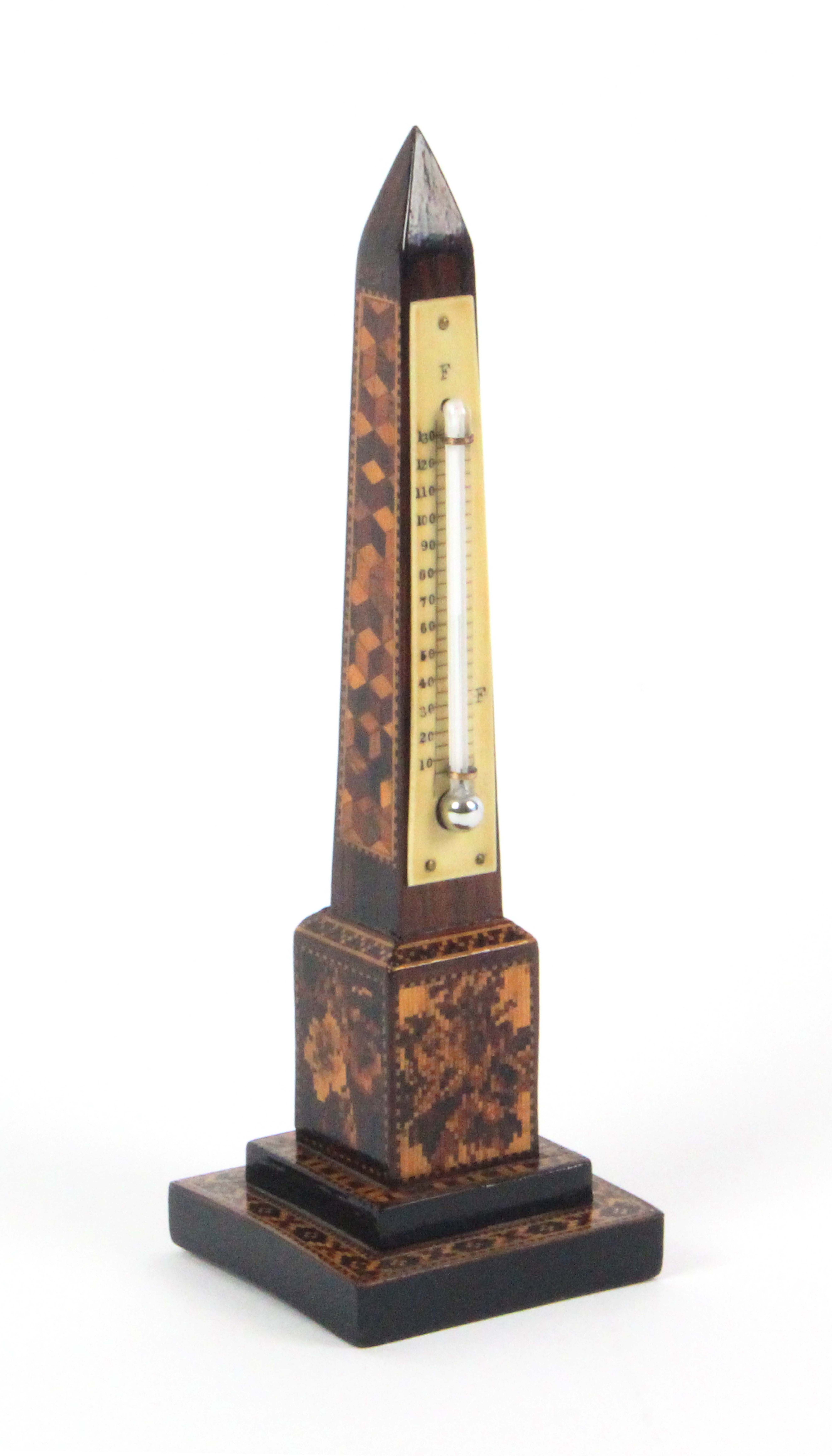 Lot 26 - A Tunbridge ware obelisk form desk thermometer, the stepped base in geometric mosaic the plinth with