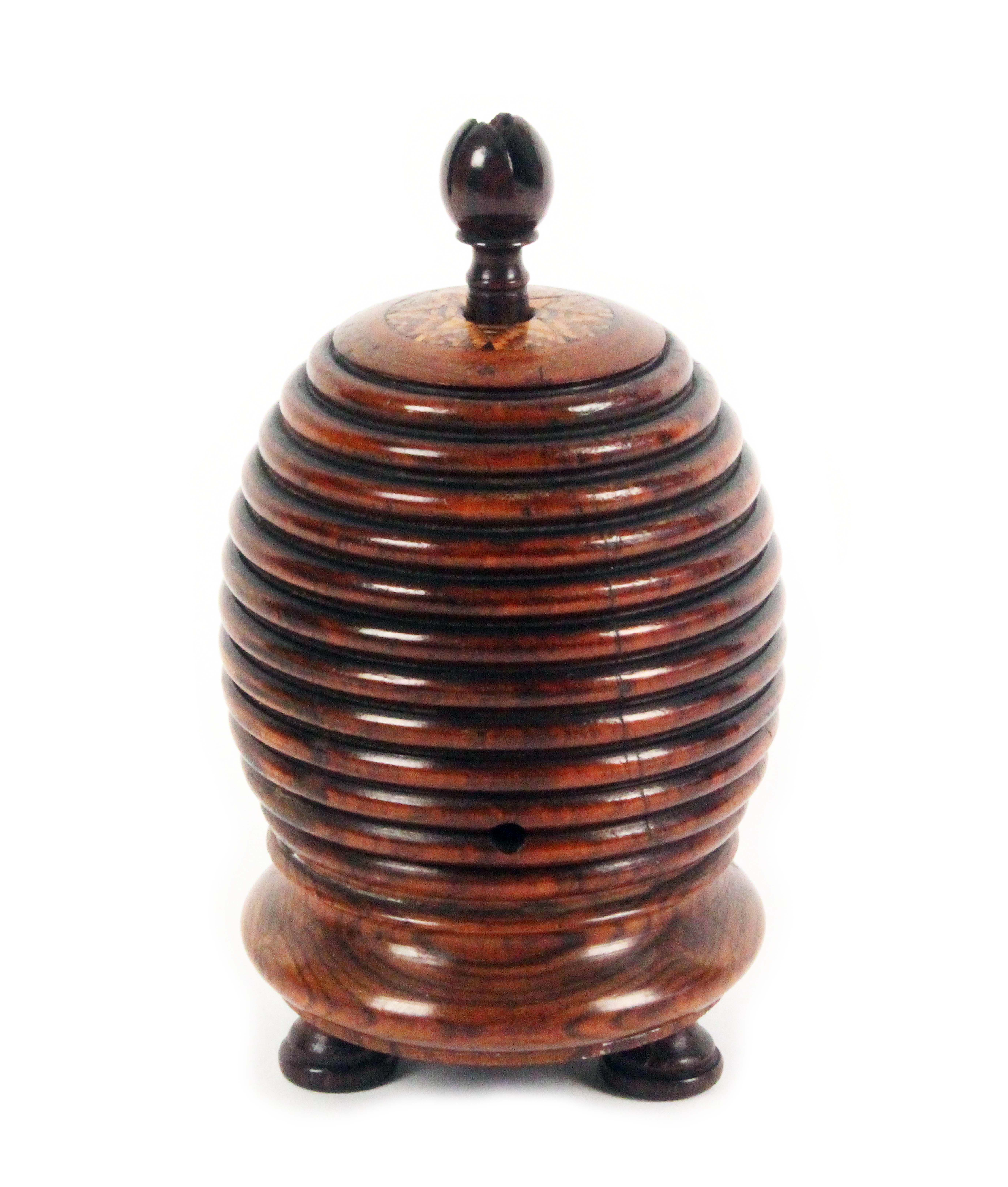 Lot 27 - An unusual rosewood Tunbridge ware string box, in the form of a bee skep raised on three turned