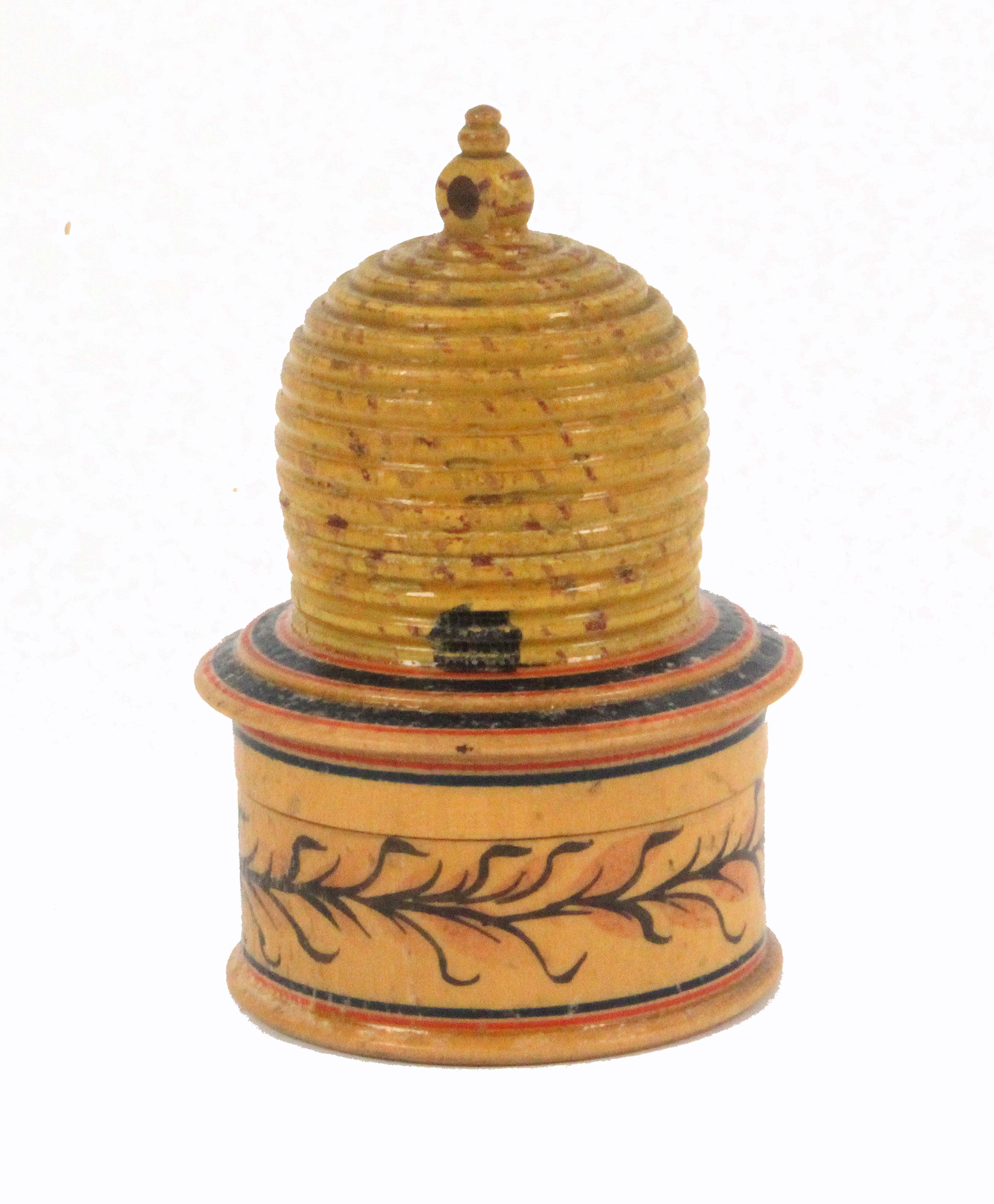 An early painted Tunbridge ware white wood pin poppet in the form of a bee skep, the circular box