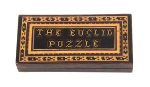 A scarce Tunbridge ware Euclid puzzle, the rosewood rectangular box with inset mosaic panel 'The
