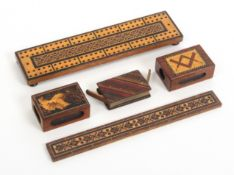 Tunbridge ware – four pieces and another, comprising a geometric mosaic cribbage board, 22.5cms, a