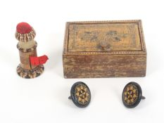 Tunbridge ware – four pieces, comprising a combination pin cushion/waxer/tape measure of cylinder