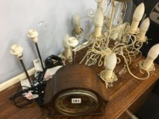 Mantle clock, chandelier and three lamps