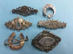 Six silver brooches
