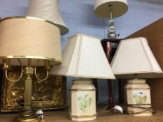 Various table lamps and a side table