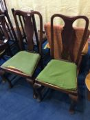Four Queen Anne style chairs