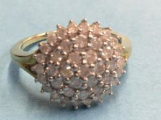 A 9ct diamond cluster ring, approx. 1ct total, size P/Q, 4.4g