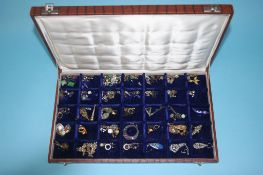 A blue velvet jewellery box and contents