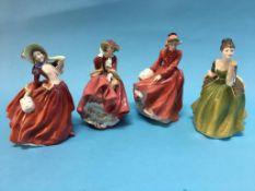 Four Royal Doulton figures including 'Autumn Breezes' etc.