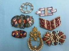 Seven enamelled and crystal buckles