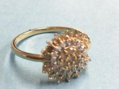 A 9k diamond cluster ring, approx. 1ct of diamonds total, size 'R'