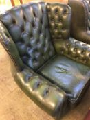 A green leather Chesterfield high back three piece suite