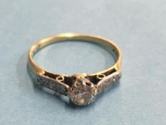 An 18ct diamond mounted ring, central stone approx. 0.25ct