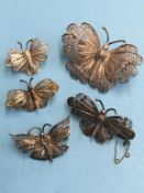 Five silver butterfly brooches