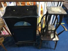 An Edwardian music cabinet, a Windsor stick back chair and a small carved table