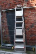 Set of aluminium property ladders and three pairs of step ladders