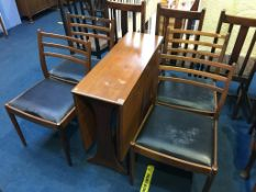 A G Plan teak table and four G Plan chairs