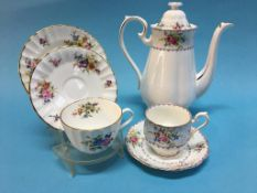 Royal Worcester 'Roanoke' tea service, a Royal Albert 'Petit Point' coffee service, Royal
