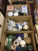 Four boxes of china including Ringtons etc.