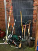 Large quantity of gardening tools including a hose reel, bin etc.