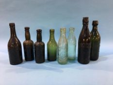Eight glass advertising bottles to include; M. A. Jones, B. P. Auckland (4), J. W. Cameron and Co.