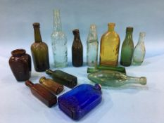 Fourteen glass advertising bottles to include; Ross and Co. Celebrated bottles, Ind Coope and Co.