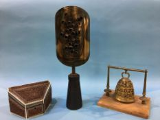 A metal modern sculpture, brass bell on wooden plinth and a wooden carved box for letters, with bone
