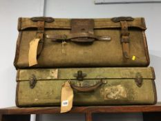 Two vintage canvas suitcases