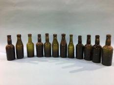 Twelve glass advertising bottles, Newcastle Upon Tyne to include, Emmerson Bros., Bradford Bros., J.
