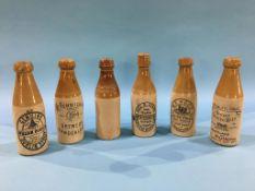 Six stoneware advertising bottles, William Robson Sunderland, George E. Evans, South Shields,
