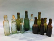 Seven 'Vaux' bottles and four Sunderland bottles, Powley, Wm Davidson and Sons, Wm Robson and E.