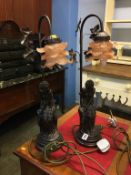 A pair of modern figural table lamps