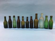 Eleven glass advertising bottles 'Durham' to include; J. J. Macknight, Wood and Watson, Wm Lowery